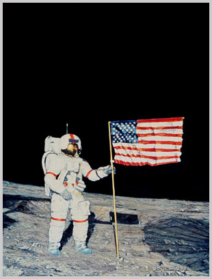 Alan Shepard poses with the U.S. Flag